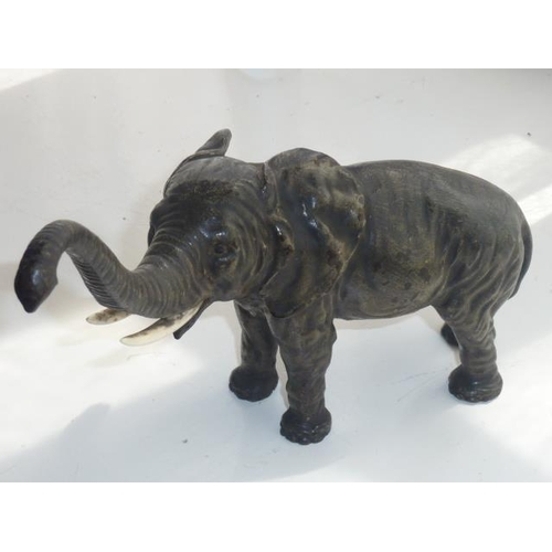 137 - A late 19th/early 20th Century cold painted Austrian style bronze Sculpture of a Tusker, the trunk r...