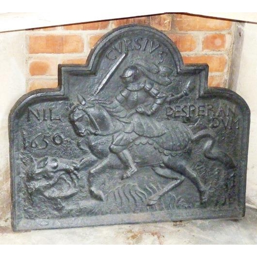 138 - A large and heavy cast iron Fire Back, the decoration in relief modelled as a Knight on horseback, 8...