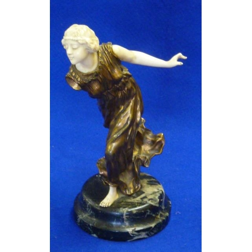 145 - An Art Deco period gilt bronze and ivory Sculpture depicting a beautiful maiden in long flowing dres...