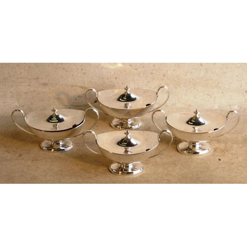 162 - A rare set of four silver George III lidded Tureens of boat-shaped form with Classical upswept handl...
