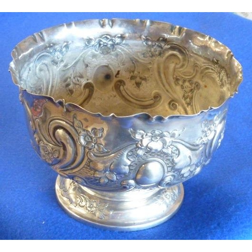 169 - A hallmarked silver Rose Bowl by the Goldsmiths & Silversmiths Company, London, hand chased and deco...