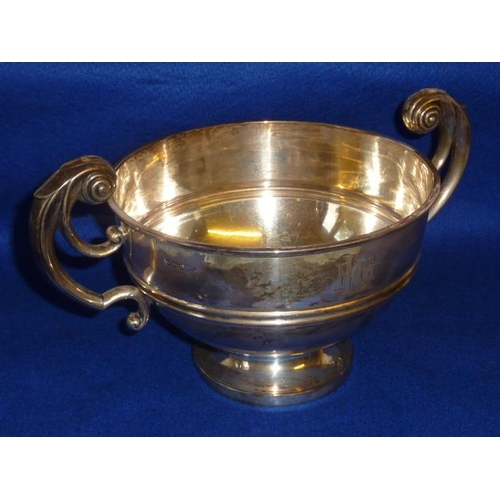 176 - A heavy two-handled Trophy style Bowl, engraved with monogram below high pierced scrolling handles a...