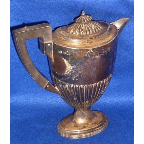 179 - An early 19th C. style hallmarked silver Hot Water Pot of oval form with reeded lid and base and on ...
