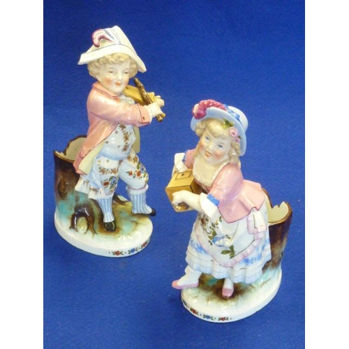 18 - A pair of late 19th Century Continental hand decorated porcelain figural Spill Vases, young boy and ...