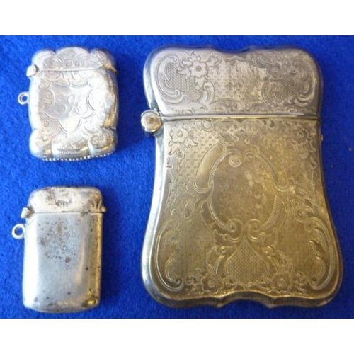 192 - A white metal engraved Card Case and two smaller silver Vestas (3)...