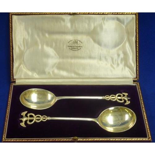 193 - A fine pair of presentation hallmarked silver Serving Spoons, each with gilded bowl and a double win...