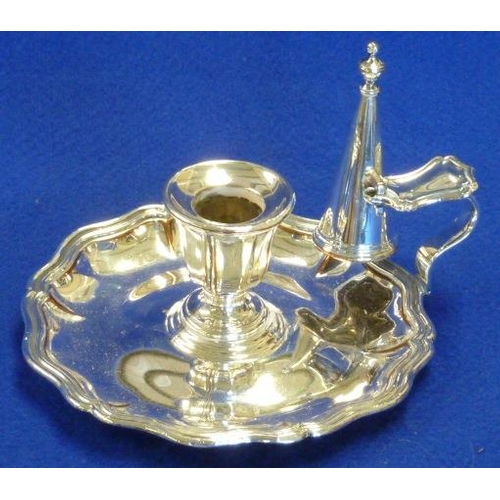 199 - A 19th Century Sheffield plated Chamberstick and Snuffer, the underside of the stand with the double...