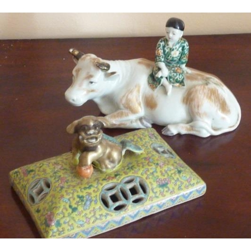 2 - A late 19th Century Chinese porcelain model of a young boy seated upon the back of a recumbent ox an...