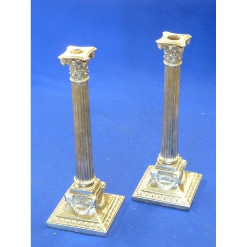 200 - A pair of Elkington & Co., late 19th Century silver plated Table Candlesticks modelled as Corinthian...