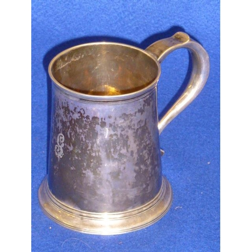 201 - An 18th Century hallmarked silver cylindrical tapering Tankard, whistle style handle and spreading c...