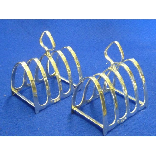 203 - A pair of small hallmarked silver arch-shaped four division Toast Racks...