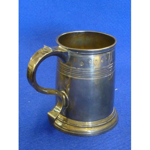 204 - An 18th Century hallmarked silver Tankard of cylindrical tapering form with scrolling handle and on ...