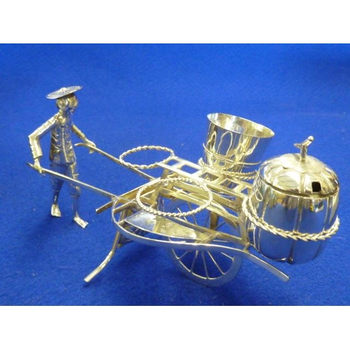 207 - A late 19th/early 20th Century novelty Chinese Cruet as a rickshaw and Chinaman (minus two circular ...