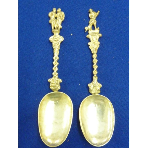216 - A pair of Continental white metal early style Spoons each with barley twist stem and leading to figu...