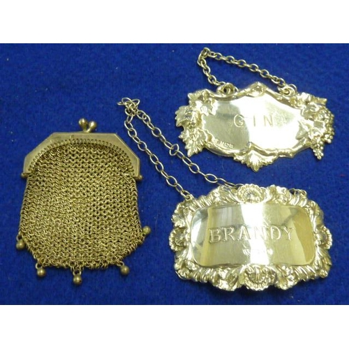 219 - Two hallmarked silver Spirit Labels (modern), Brandy and Gin, together with a ladies white metal cha...