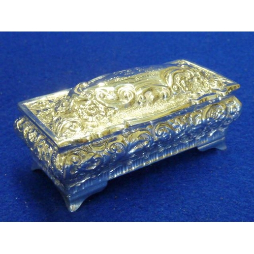 223 - A fine quality hallmarked silver rectangular Box and hinged Cover profusely decorated repoussé style...