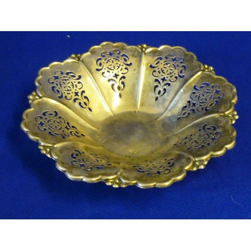 227 - A hallmarked silver flower head-shaped Dish with petal shaped reticulated panels, 24.5cm diameter, a...