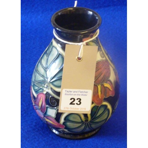 23 - A modern Moorcroft baluster-shaped pottery Vase, tube-lined with various flowers and leaves etc., va...