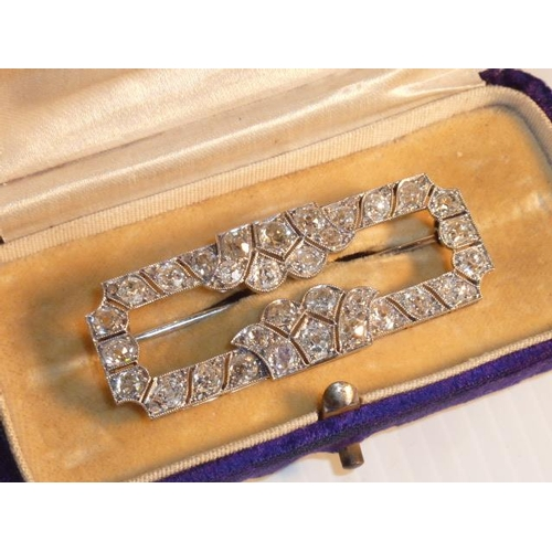 239 - A circa 1920 platinum and diamond Brooch set with 32 diamonds approx. 6.3 carats of old cut stones o...