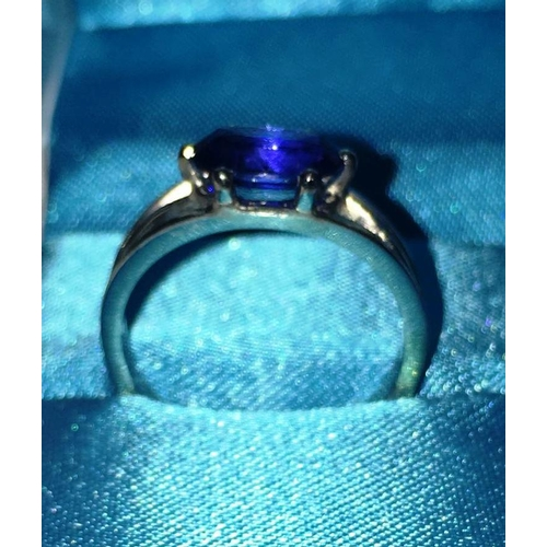 247 - A hallmarked platinum single sapphire Ring set with an oval cornflower blue sapphire which measures ...