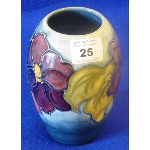 25 - A Moorcroft pottery baluster-shaped tube lined Vase in the Clematis pattern, painted green, signatur...
