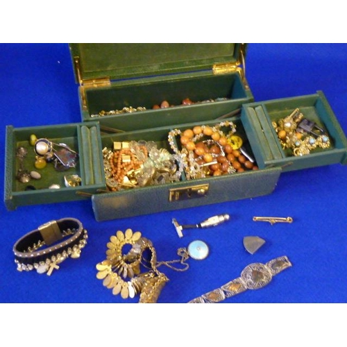 255 - A green leather Jewel Box containing a variety of ladies Costume Jewellery and associated items to i...