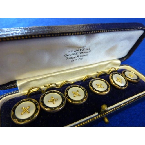 261 - A cased set of six 9 carat gold and enamel Buttons (some damage)...