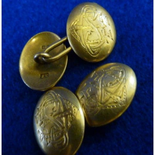 262 - A pair of gentlemen's 18 carat yellow gold oval Cuff Links engraved with monograms, approx. 11.3g...