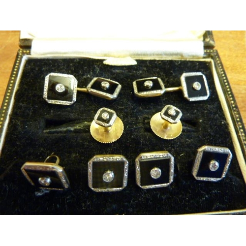 267 - A gentlemen's cased 9 carat yellow gold, black enamel and diamond set Cuff Links, Buttons and Stud s...