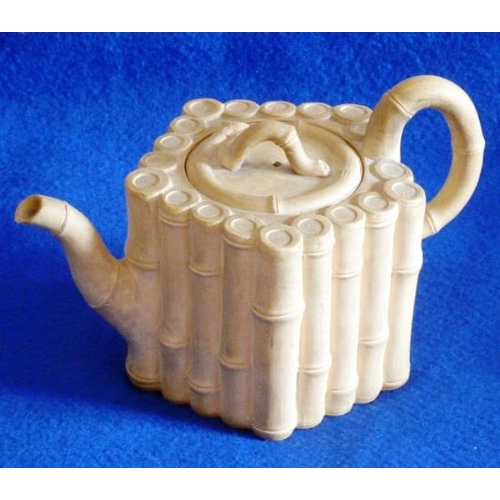 27 - A late 18th Century basalt teapot by Wedgwood & Bentley (impressed mark to underside), the lid, hand...