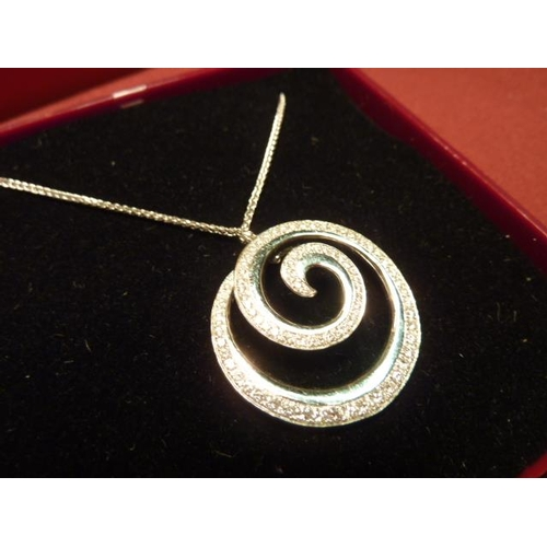 274 - An 18 carat gold multi diamond set swirl Pendant and Chain...