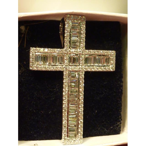 275 - A superb 18 carat white gold Cross set with baguette diamonds and brilliant cut diamonds...