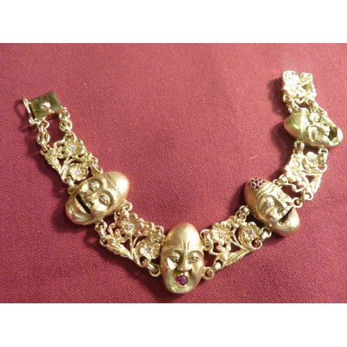 277 - A very heavy 18 carat gold Bracelet set with mask heads and diamonds...