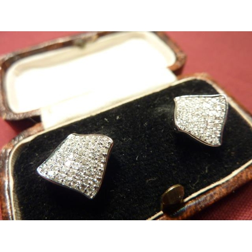 278 - A pair of 18 carat gold Stud Earrings set with 98 diamonds...
