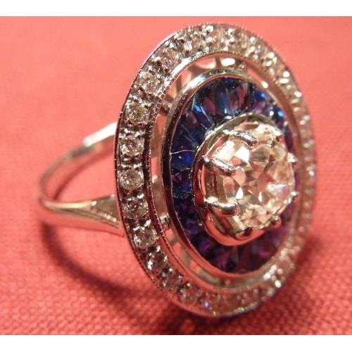 279 - An 18 carat white gold Ring 1 carat diamond with sapphire and diamond surround...