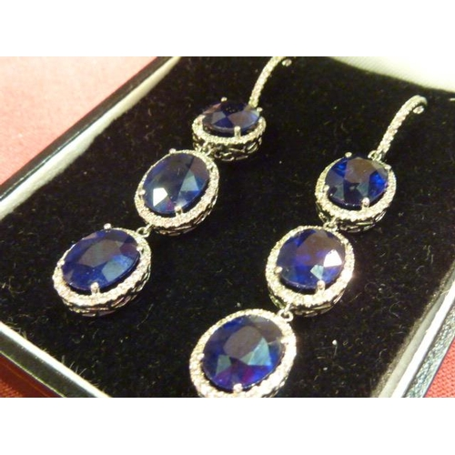 281 - A pair of 18 carat gold Earrings consisting of six 2 carat sapphires set as sapphire and diamond clu...