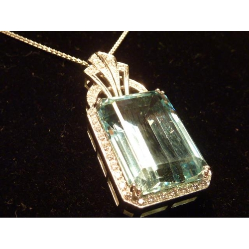 282 - A superb 35 carat aquamarine and diamond cluster Pendant on an 18 carat white gold Chain...