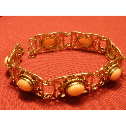 283 - A 9 carat gold Bracelet with seven coral links...