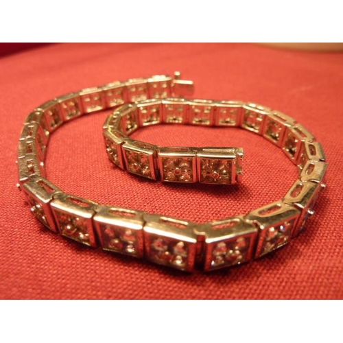 284 - A large and heavy 18 carat gold sapphire set Bracelet...