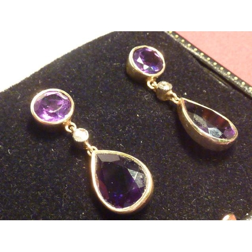287 - A pair of heavy 14 carat gold amethyst and diamond Earrings...