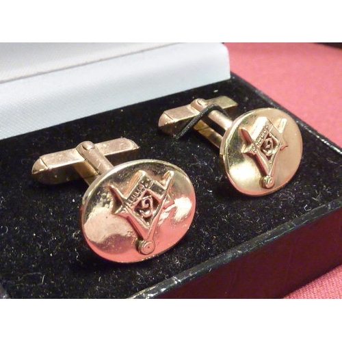 288 - A cased pair of 9 carat gold Masonic Cuff Links...