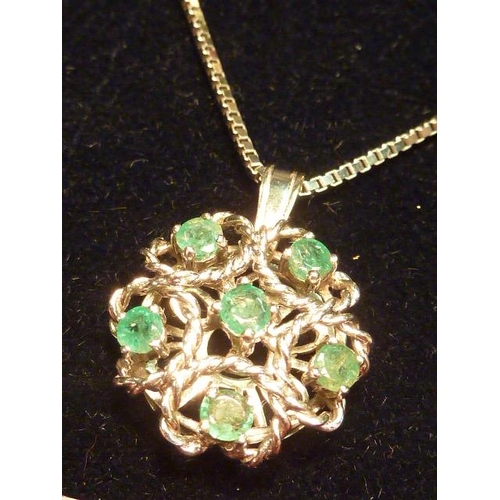 289 - A 14 carat white gold Pendant set with emeralds on a 14 carat Chain...