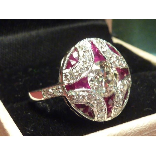 290 - An 18 carat white gold ladies Ring, the centre stone 1 carat diamond surrounded by rubies and diamon...