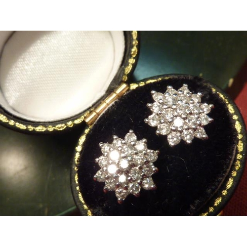 294 - A pair of 18 carat white gold and diamond cluster Ear Studs...