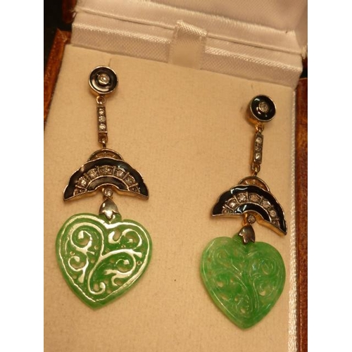 297 - A pair of carved jade enamel and diamond drop Earrings...