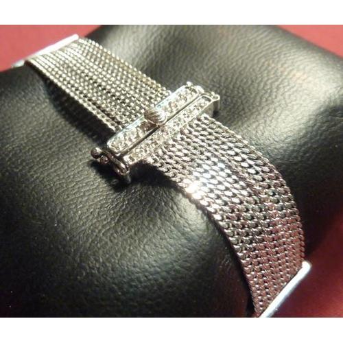 298 - An 18 carat white gold seven-strand Bracelet set with 40 diamonds...