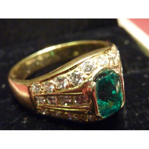 301 - A fine and large 18 carat gold emerald and diamond Ring...