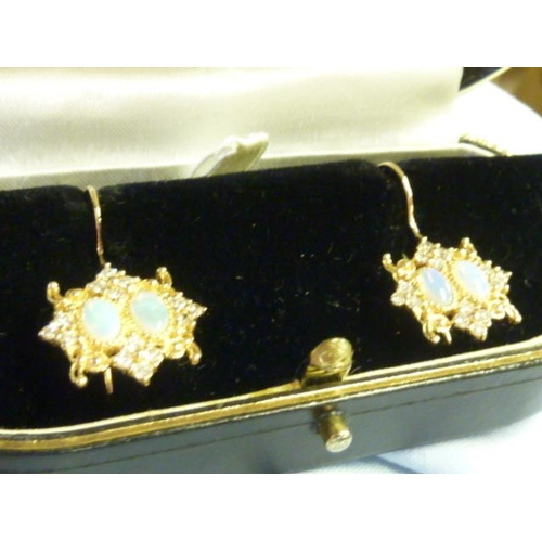 302 - A pair of 15 carat gold opal and diamond Earrings...