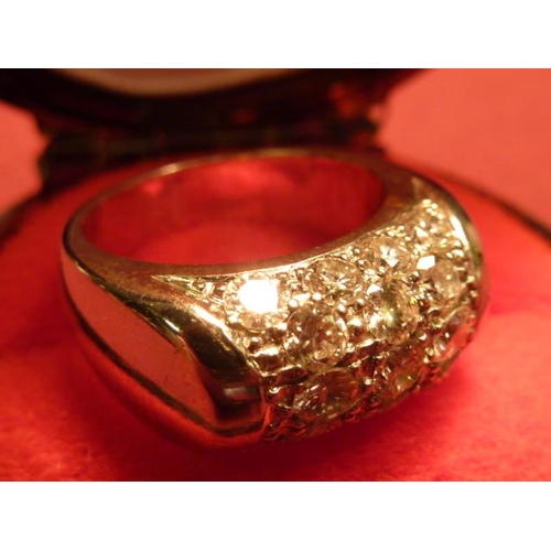 305 - A heavy 18 carat white gold Ring set with 17 fine diamonds...