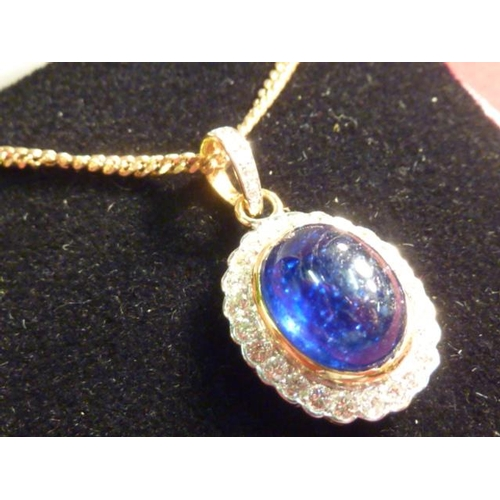306 - A cabouchon sapphire and diamond Pendant on a 9 carat gold Chain...